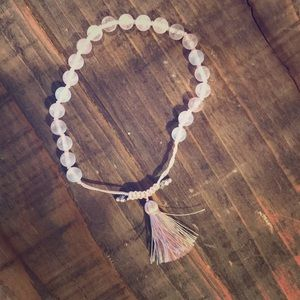 Pink quartz beaded bracelet with tassel.